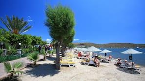 On the beach, sun-loungers, beach umbrellas, beach volleyball