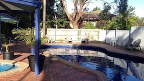 Outdoor pool, open noon to 8 PM, pool loungers