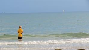 On the beach, white sand, beach cabanas, beach towels