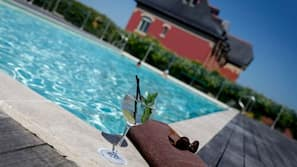 Seasonal outdoor pool, open 9 AM to 9 PM, pool umbrellas, pool loungers