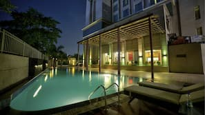 Outdoor pool, open 8:30 AM to 6:30 PM, pool umbrellas