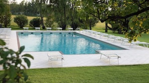Outdoor pool, open 8:30 AM to 8 PM, pool umbrellas