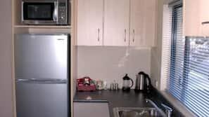 Fridge, microwave, hob, electric kettle
