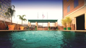 Outdoor pool, open 11:00 AM to 6:00 PM, pool umbrellas, pool loungers