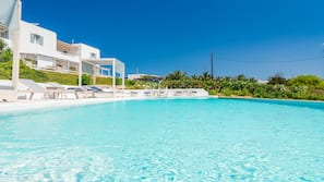 Outdoor pool, open 9 AM to 9 PM, pool umbrellas, sun loungers