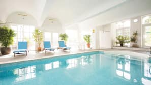 Indoor pool, open 8:00 AM to 9:00 PM, pool loungers
