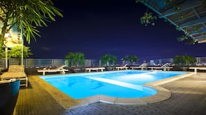Outdoor pool, a rooftop pool, pool umbrellas, pool loungers