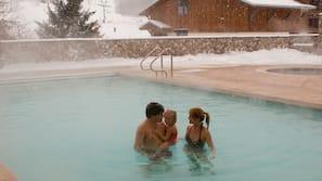 Indoor pool, outdoor pool, open 8 AM to 11 PM, pool umbrellas