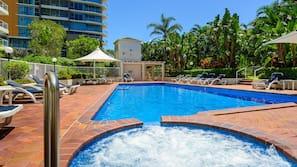 Indoor pool, outdoor pool, pool umbrellas, pool loungers
