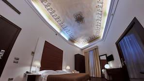 Italiaanse Frette-lakens, luxe beddengoed, donzen dekbedden, een minibar