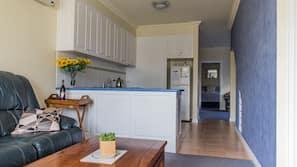 Fridge, microwave, coffee/tea maker, cookware/dishes/utensils