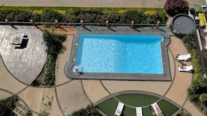 Outdoor pool, open 6 AM to 8:00 PM, pool loungers