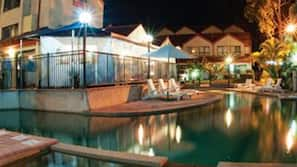 Outdoor pool, open 8:30 AM to 9:30 PM, pool umbrellas, pool loungers