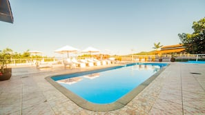 Outdoor pool, open 9 AM to 10 PM, pool umbrellas, pool loungers
