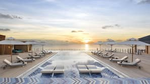 3 outdoor pools, open 8:00 AM to 6:00 PM, free cabanas, pool umbrellas