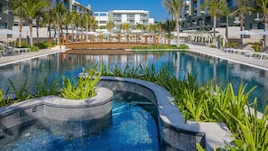 2 outdoor pools, open 8:00 AM to 8:00 PM, pool umbrellas, sun loungers
