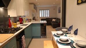 Fridge, dishwasher, highchair, cookware/dishes/utensils