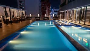 Outdoor pool, open 7:00 AM to 10:00 PM, free cabanas, sun loungers
