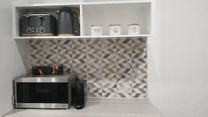 Fridge, microwave, coffee/tea maker, toaster