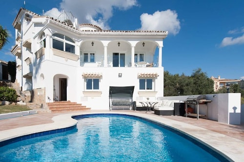 5BR 4BA Villa Romano With Panoramic Sea and Golf Views in Elviria, Marbella