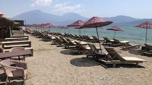 Private beach, sun loungers, beach umbrellas, beach yoga