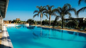Seasonal outdoor pool, open 11:00 AM to 7:00 PM, pool loungers