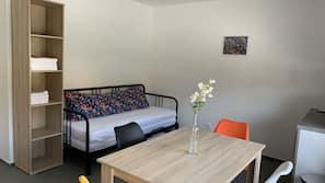 Desk, laptop workspace, blackout curtains, free cots/infant beds