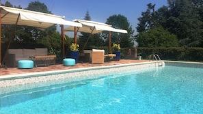 Seasonal outdoor pool, open 9:00 AM to 8:30 PM, pool umbrellas