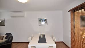 Flat-screen TV, DVD player, ping pong table, stereo