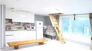 Full-size fridge, microwave, cookware/dishes/utensils