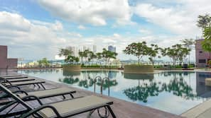 3 outdoor pools, open 7:30 AM to 8:00 PM, pool umbrellas, pool loungers