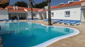 Outdoor pool, open 8:00 AM to midnight, pool loungers