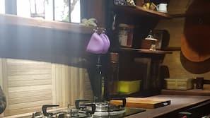 Full-sized fridge, hob, coffee/tea maker, electric kettle