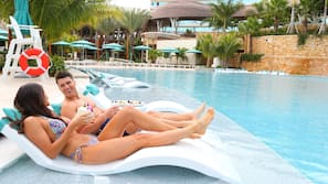 Outdoor pool, open 8:00 AM to 7:00 PM, pool cabanas (surcharge)