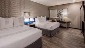 Premium bedding, memory foam beds, laptop workspace, blackout drapes