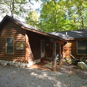 Snuggle up at This log Cabin in Northport-fireplace-close to Beaches