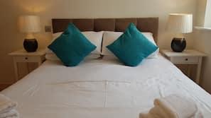 Premium bedding, individually furnished, laptop workspace