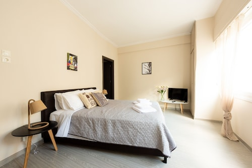 Homely Apartments by Athens Stay
