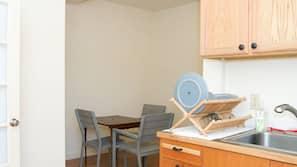 Mini-fridge, stovetop, cookware/dishes/utensils