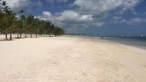 On the beach, white sand