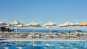 Outdoor pool, open 10:30 AM to 6:30 PM, pool umbrellas, sun loungers