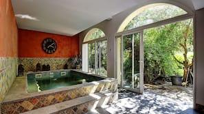 Indoor pool, a heated pool, pool loungers
