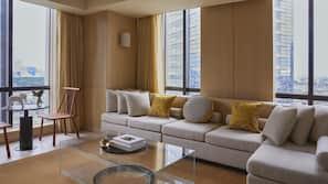 Premium bedding, down duvets, free minibar items, in-room safe