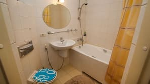 Combined shower/tub, hair dryer, towels, soap