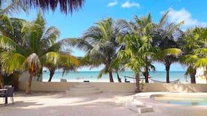 On the beach, white sand, sun loungers, beach bar