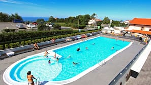 Seasonal outdoor pool, open 10:30 AM to 8:00 PM, pool umbrellas