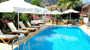 Outdoor pool, open 9:00 AM to 7:00 PM, pool umbrellas, pool loungers