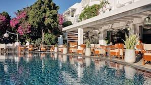 Seasonal outdoor pool, open 11:00 AM to 6:00 PM, pool umbrellas