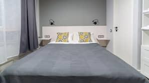 Premium bedding, down comforters, minibar, desk