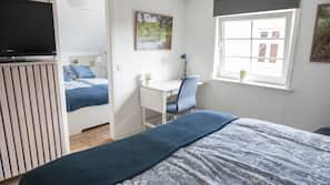 Down duvet, desk, blackout curtains, iron/ironing board